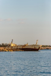 A large cargo ship that ran aground in the Sea Caves area of Paphos County, near Coral Bay, during a storm on December 8, 2011 after an engine failure.