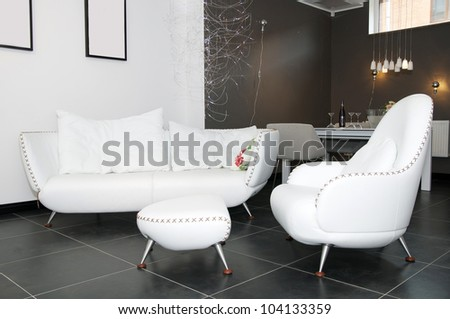 a large comfortable lounge, a white