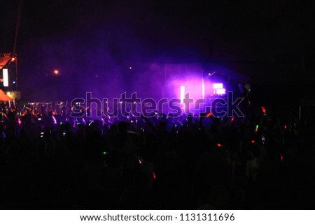 a large concert crowd #1131311696