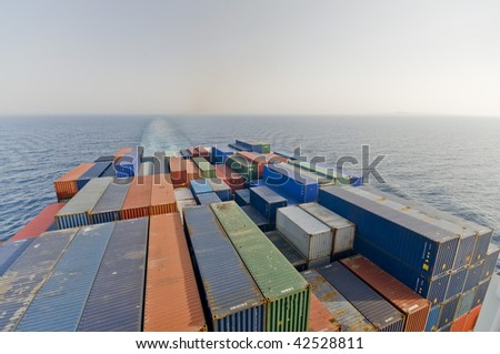 a large container vessel ship and the horizon, no logos in this picture
