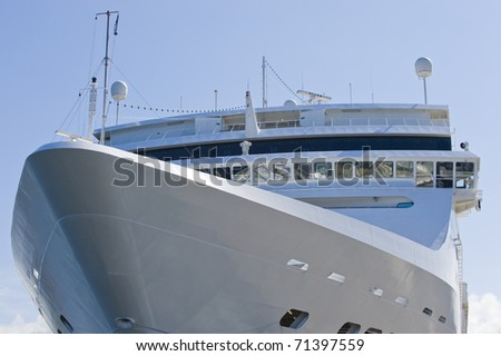 A large cruise ship detail in a port on blue sky in summer.