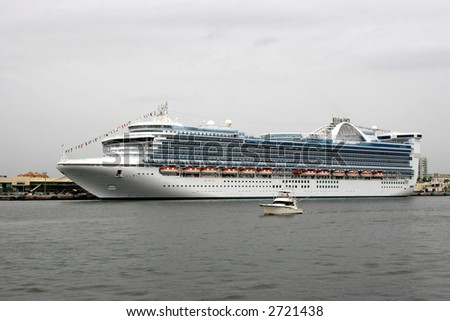 A large cruise ship, ocean liner, docked in Fort Lauderdale, Florida.