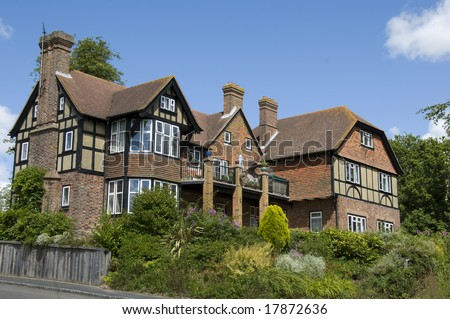 A Large Detached Tudor Style House With A Blue Sky Stock
