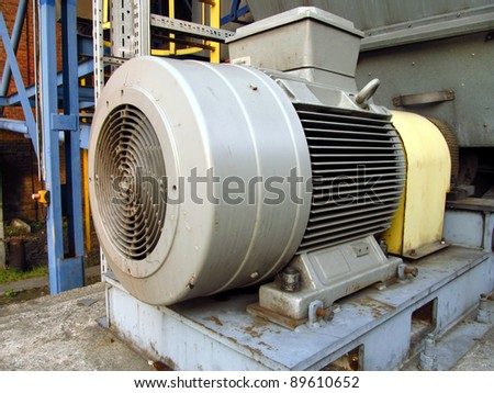 a large electric motor to drive the fan exhaust gases on the shadow stack - stock photo