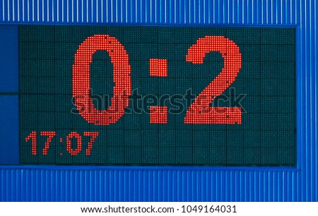 A large electronic advertisement board with numbers 0 and 2 #1049164031