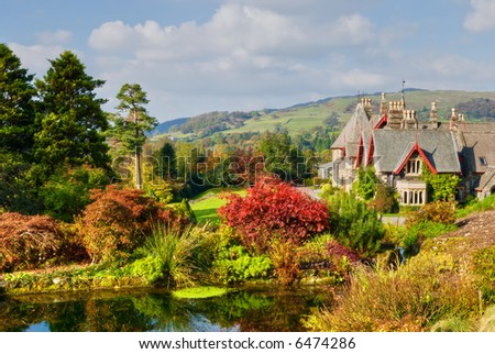 A large English coutry house and garden in rich Autumn colours