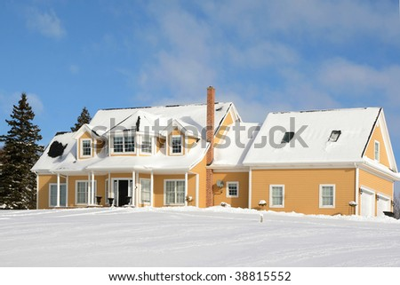 A large family home buried in snow in the depths of winter.