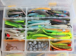 A large fisherman's tackle box fully stocked with lures and gear for fishing