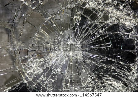 a large glass pane  broken in pieces