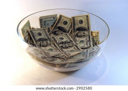A large glass punch bowl full of MONEY!
