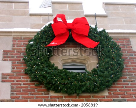 A Large Green Wreath With a Red Bow