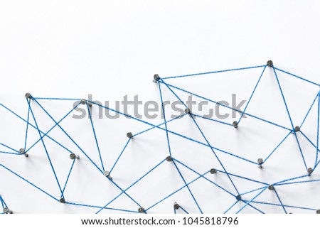 A large grid of pins connected with string. Communication, technology, network concept #1045818796