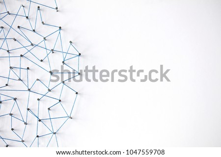 A large grid of pins connected with string. Communication, technology, network concept #1047559708