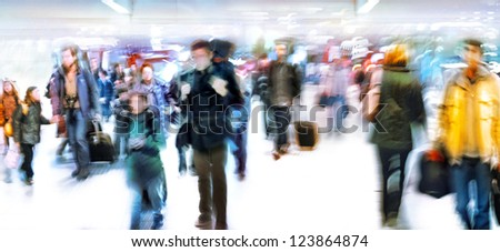 A large group of arriving passengers. Panorama. Blurred motion. White background.