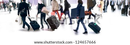 A large group of arriving passengers. Panorama. Motion blur.