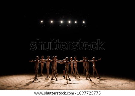A large group of children rehearsing and dancing the ballet #1097725775