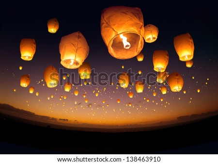 Photo of  A large group of chinese flying lanterns.