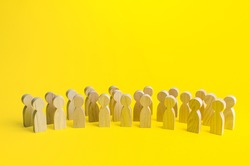 A large group of figurines of people on a yellow background. Social survey and public opinion, electorate. Population and citizens. Human resource, search for candidates. Personnel Management.