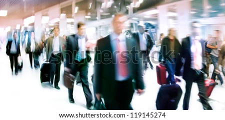 A large group of people. Panorama. People walking against a light background. Motion blur. - stock photo