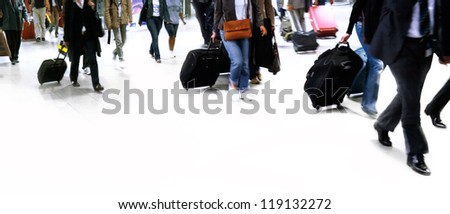 A large group of people walking. Hurrying passengers. Motion blur.