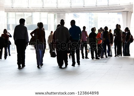 A large group of tourists. Panorama. Silhouettes. Urban scene.