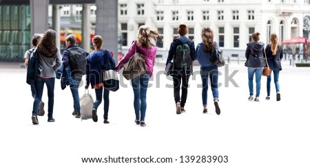 A large group of young people. Urban scene.