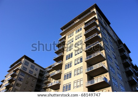 A large high rise commercial apartment, condominium building.