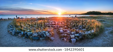 A large labyrinth of stones on the shores of the White Sea on the Solovetsky Islands at the Cape of Labyrinths in the light of the setting autumn sun Stock photo ©