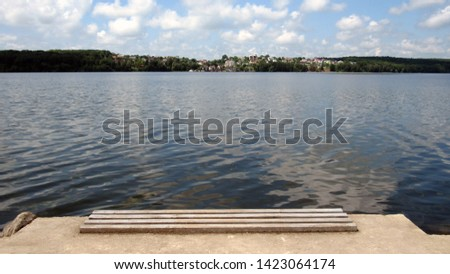 a large lake in the city in the summer #1423064174