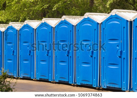 A large number of street toilets in the city park.