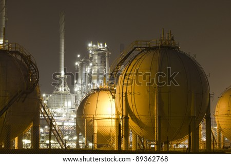 A large oil-refinery plant with gas storage tanks