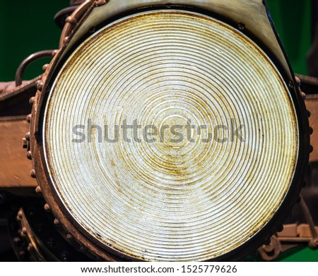 A large old fashioned headlamp. Big round electrical light with grooves and a bit of grime to give it a real worn and rustic look. Brighter days, bright ideas, shine on an outlook or future. #1525779626
