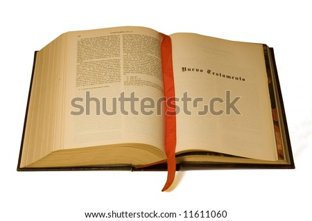 A large open Bible in Spanish language, open to the New Testament. Isolated