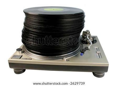 a large pile of records stacked on top of each other on a technics turntable