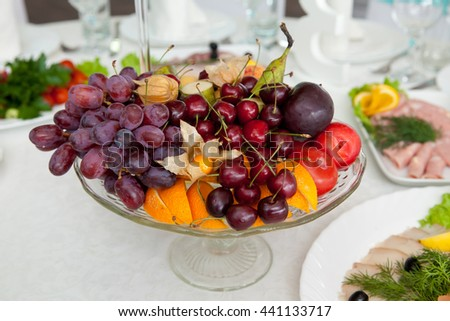 a large platter of fruit and berries on the table #441133717