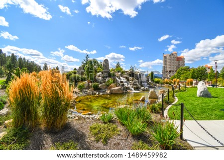 A large pond with waterfall inside the public McEuen Park near resorts and Tubbs Hill in the lakefront town of Coeur d'Alene, Idaho. Photo stock ©