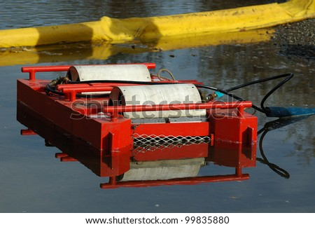 a large powered surface oil skimmer at a flammable petroleum liquid spill on a river