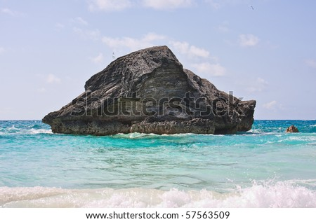 A large rock in the atlantic ocean in the coastal waters of Bermuda. Photo was taken at Horseshoe Bay in Bermuda.