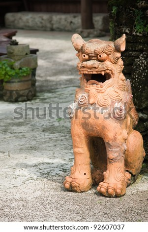 A large shisa dog/lion, protecting the entrance to a home.