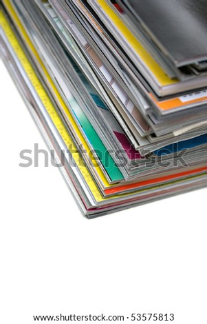 A large stack of magazines piled high isolated over white with copyspace.  Shallow depth of field.