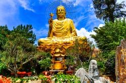 A large statue of golden Buddha. Dalat Vietnam