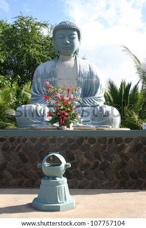 A large statue of the Buddha sits at an outdoor shrine on the Hawaiian island of Maui