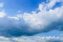 A large storm cloud on blue sky