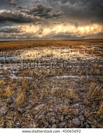 A large storm leaves a flooded field in its wake