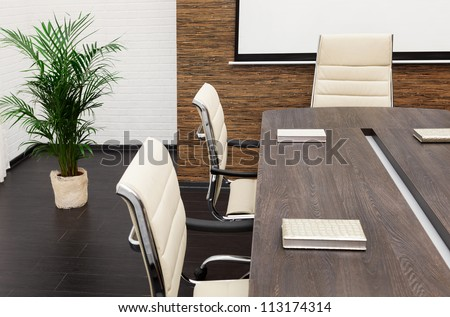 A Large Table And Chairs In A Modern Conference Room Stock Photo ...