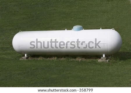 A large tank for holding propane gas.