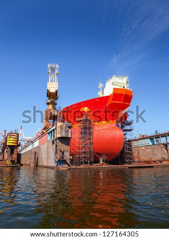 A large tanker repairs in dry dock. Shipyard Gdansk, Poland.