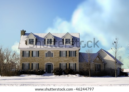 A large three story house made of stones taken during the winter.