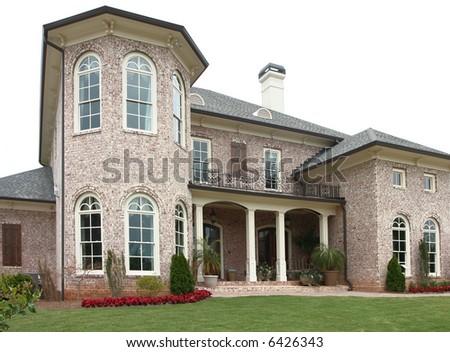 A large upper-income class brick home.