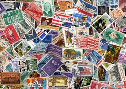 A large USA postage stamp collection background